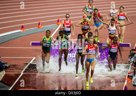 Action of women competing in the Women's 3000m Steeplechase at the Olympic Summer Games, London 2012 - Stock Photo