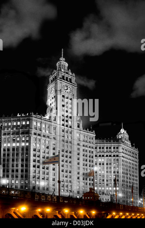 Night photograph of the Wrigley Building with the lower level Michigan avenue bridge in the foreground. - Stock Photo