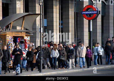 Crowded pavement and underground sign in fron of Portcullis House, Westminster Station, Westminster, London, England, - Stock Photo