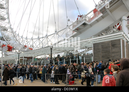 People waiting in line in front of the London Eye, London, England, UK, Europe - Stock Photo