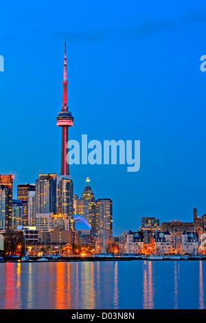 Skyline of Toronto City seen from Ontario Place, Toronto, Ontario, Canada at dusk. - Stock Photo