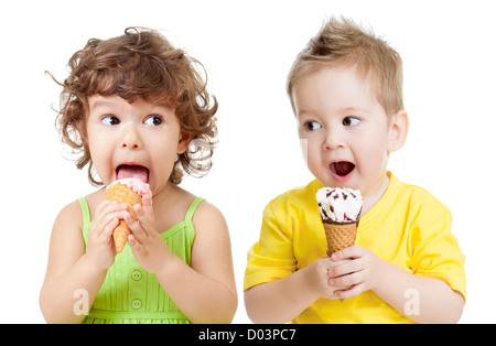 children or kids, little girl and boy eating ice cream isolated on white - Stock Photo