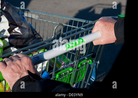 Man pushing ASDA shopping trolley England UK United Kingdom GB Great Britain - Stock Photo