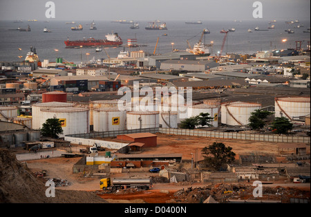 ANGOLA Luanda by night , harbor and anchorage, in front oil tanks of Sonangol the national oil company - Stock Photo