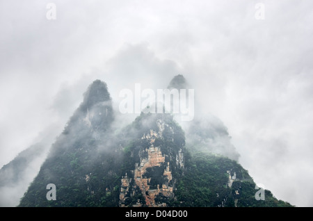 Karst Hills Surrounded By Mist Like in a Chinese Painting - Stock Photo
