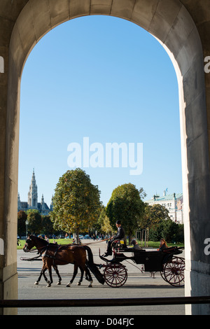 Traditional horses and carriage (also called Fiaker) passing the famous Hofburg on October 3, 2012 in Vienna, Austria. - Stock Photo