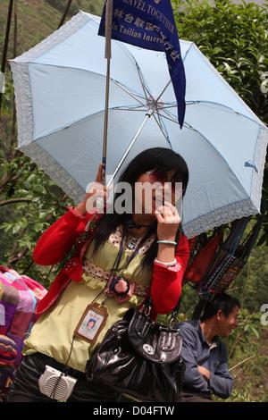 Tour guide to Dragon's Backbone Rice Terraces, Longsheng, Guangxi - Stock Photo