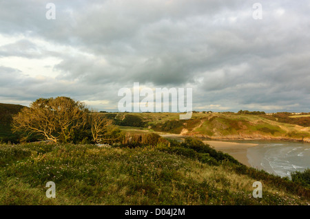 Looking Eastwards over the beach at Three Cliffs Bay in Gower, the view from Penmaen Burrows. - Stock Photo