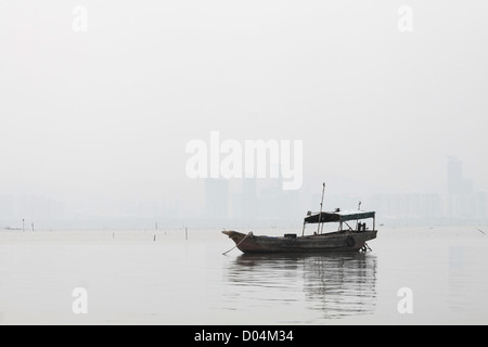Lonely boat on the sea in black and white toned - Stock Photo