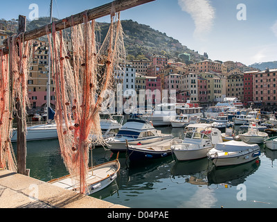 View to the port of Camogli, Italy through a fishnet - Stock Photo