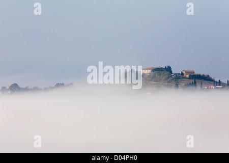 europe, italy, tuscany, siena, crete senesi, landscape, mist - Stock Photo