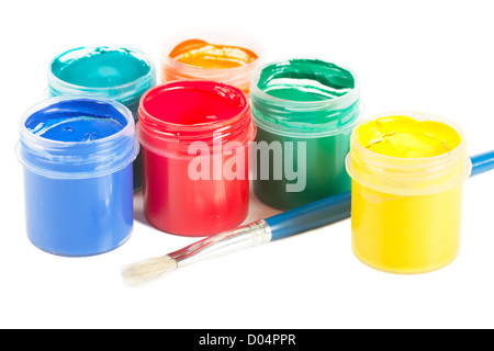 Closeup view of colorful cans with gouache and brush - Stock Photo