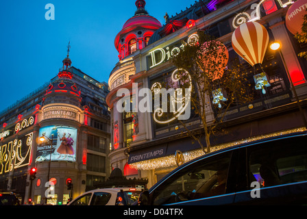 Paris, France, French Department Store, Printemps, with Luxury Christmas Decorations, Lighting at Night, Dior Advertising - Stock Photo