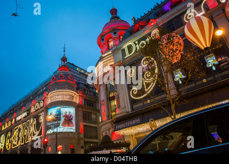 Paris, France, French Department Store, Printemps, with Christmas Decorations, Lighting at Night, Dior Advertising - Stock Photo