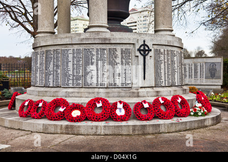 Poppy wreaths laid at the cenotaph in Coatbridge, North Lanarkshire, Scotland, UK on Remembrance Sunday, 2012 - Stock Photo