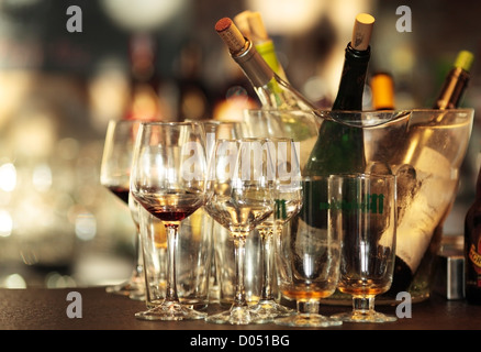 Empty wine glasses on a bar. - Stock Photo