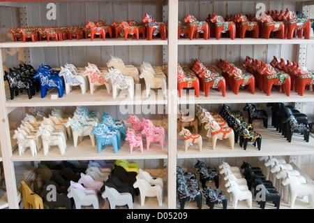 Dala horse Dalarna  Dalecarlian horses swedish sweden traditional souvenir souvenirs shelf shelves full off - Stock Photo