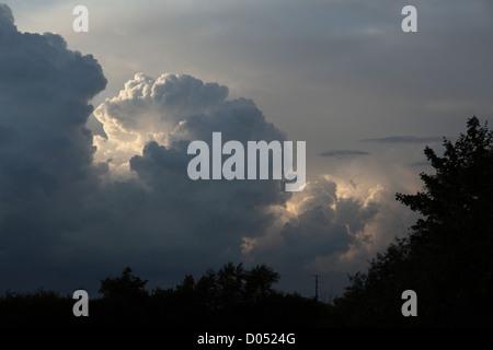 threatening cumulonimbus clouds seen in the UK in the late summer evening threatening a summer storm - Stock Photo