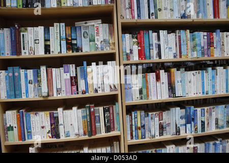 books for sale in charity shop, Lincoln, Lincolnshire, England, UK - Stock Photo