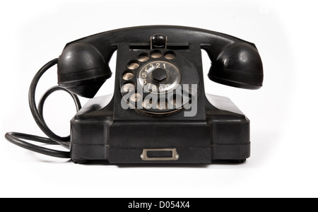 Old black phone with dust and scratches, isolated on white background - Stock Photo
