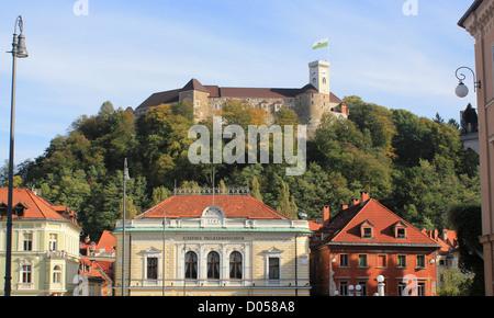 Philharmonic Hall and castle of Ljubljana, Congress square, Ljubljana, Slovenia - Stock Photo