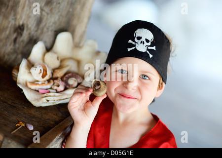 Portrait of playful pirate boy - Stock Photo