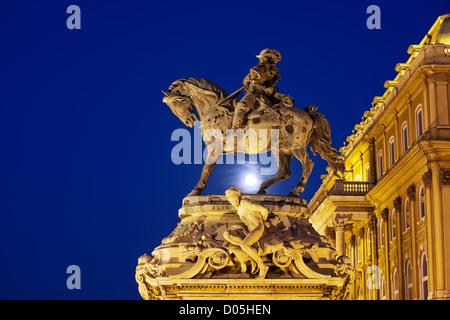 Prince Eugene of Savoy statue from 1897 at full moon night, next to the Buda Castle (Royal Palace) in Budapest, - Stock Photo