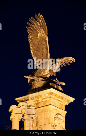 Turul Bird bronze statue from 1905 at night, located next to the Buda Castle in Budapest, Hungary. - Stock Photo