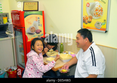 Shanghai China Huangpu District Sichuan Road restaurant Asian man father woman mother girl daughter family eating - Stock Photo