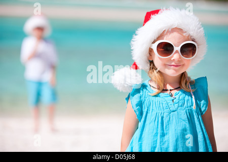 Little girl in Santa hat - Stock Photo