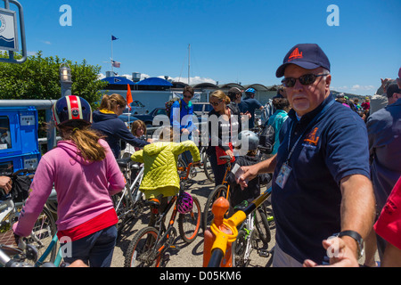 San Francisco - Sausalito district, north of the Golden Gate bridge. Cyclists queue for the ferry to Fisherman's - Stock Photo