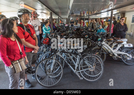 San Francisco - bicycles and cyclists on the Sausalito to Fisherman's Wharf bay ferry. - Stock Photo