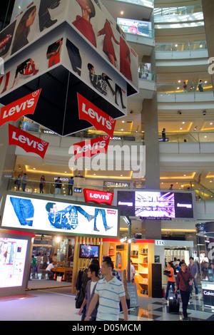 Shanghai China Huangpu District Xizang Road People's Square Raffles City hanzi Asian man fashion advertising Levi's - Stock Photo