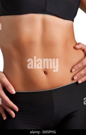 Closeup of a fit woman's abs isolated on a white background - Stock Photo
