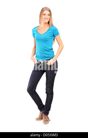 Full length portrait of a young woman standing with her hands in pocket isolated on white background - Stock Photo