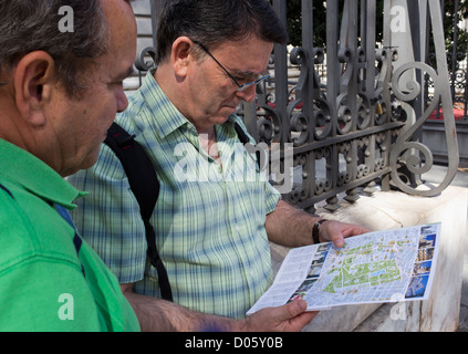 Madrid, Spain. Tourists following directions on map. - Stock Photo