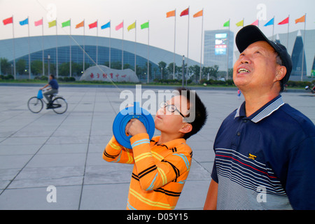 Shanghai China Pudong Xin District Oriental Sports Center Asian man senior grandfather boy grandson learning teaching - Stock Photo