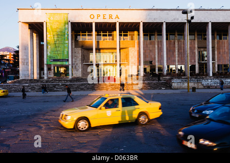 Tirana. Yellow cab and National Theatre of Opera and Ballet of Albania - Stock Photo