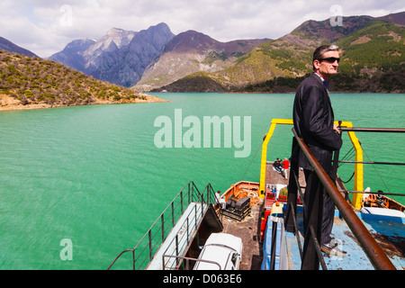 Landscape and passenger on the Koman-Fierze ferry through the Koman Lake and the Drina Valley in Northern Albania - Stock Photo