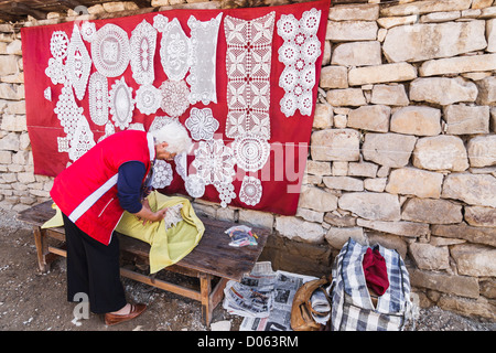 Old woman selling traditional embroidering in Arbanasi village, 4 kms from Veliko Tarnovo, Bulgaria - Stock Photo