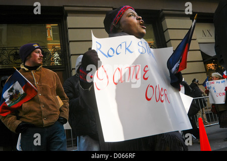 coalition of Haitian Americans and members of Local 1199, Health and Hospital Workers Union, protest against violent - Stock Photo