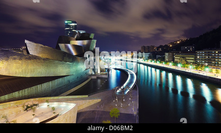 Panoramic night view from La Salve bridge of Guggenheim museum and River Nervion, Bilbao, Biscay, Basque Country, - Stock Photo
