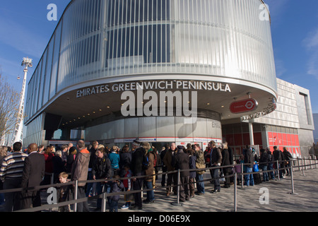 Passengers queue at the southern Greenwich Peninsular terminus of the (Emirates) Thames Cable Car, London. There - Stock Photo