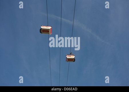 Two of the ten gondolas that cross the River Thames of the (Emirates) Thames Cable Car, each with a maximum capacity - Stock Photo