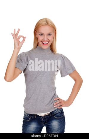 smiling beautiful woman showing okay gesture, isolated on white background - Stock Photo