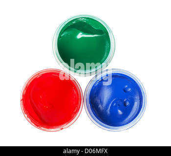 Closeup view of red, green and blue cans with gouache - Stock Photo