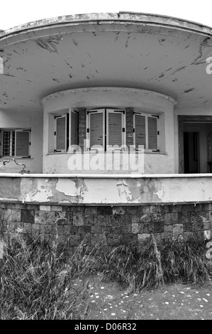 Futuristic house from the 1960s abandoned in ruin. Round roof and porch detail. - Stock Photo