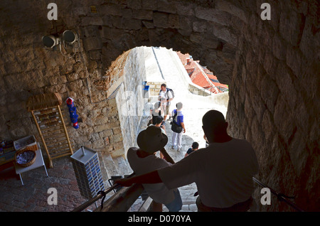 Dubrovnik People: Tourists walking the Old City Town Walls - Stock Photo