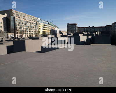 Modern apartment buildings overlooking the Holocaust Memorial in Berlin, Germany. - Stock Photo