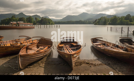 Old wooden rowing boats in the evening on the beach at Derwentwater, near Keswick, Lake District, England. - Stock Photo